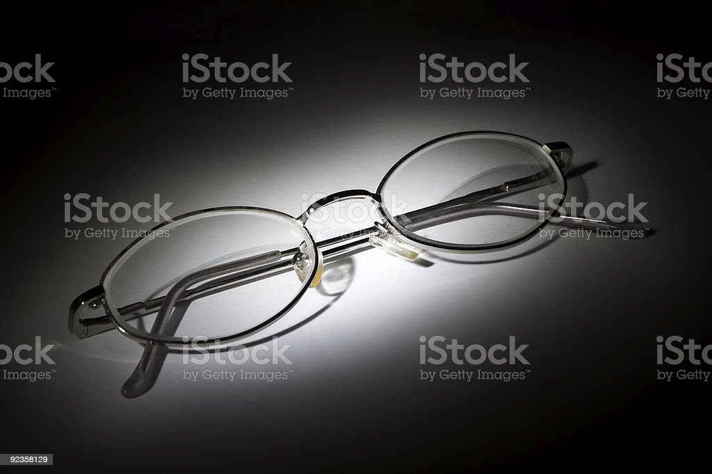 Glasses on white background in the darkness royalty-free stock photo