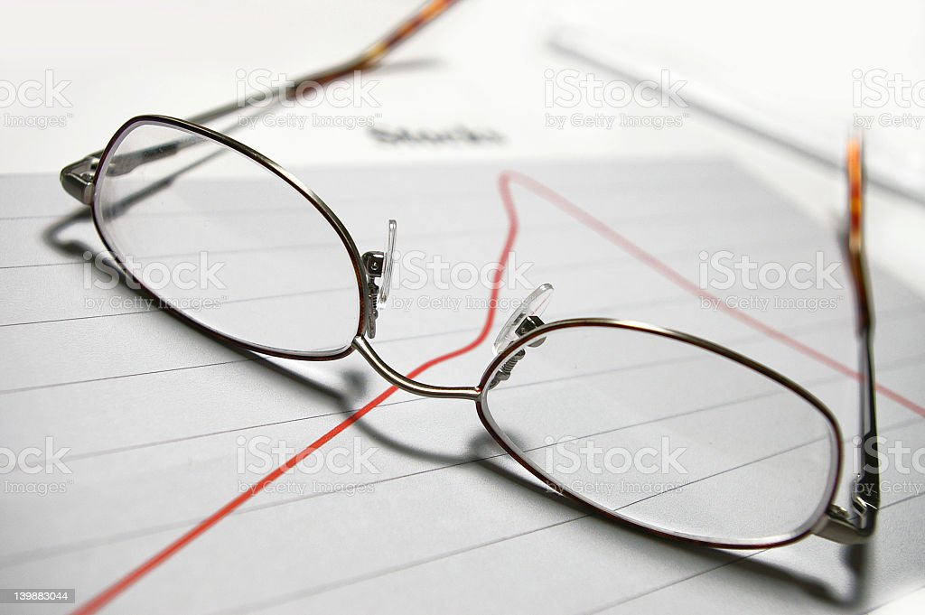 glasses over graphs royalty-free stock photo