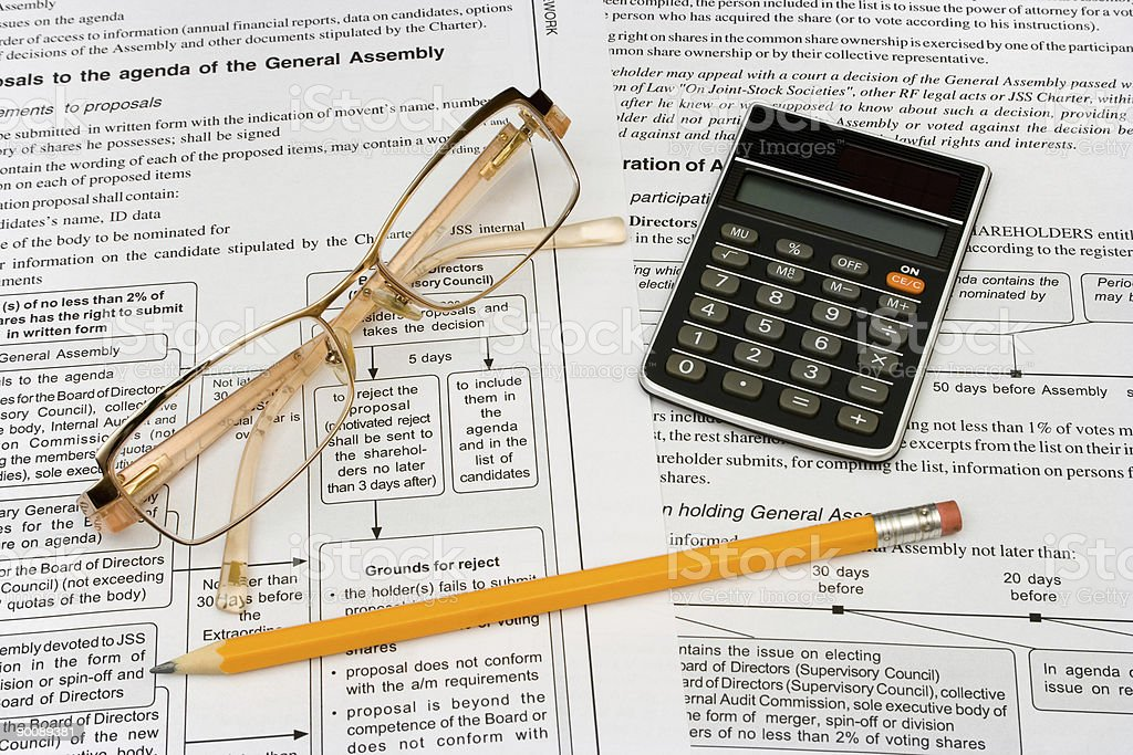 Glasses, pencil and calculator royalty-free stock photo