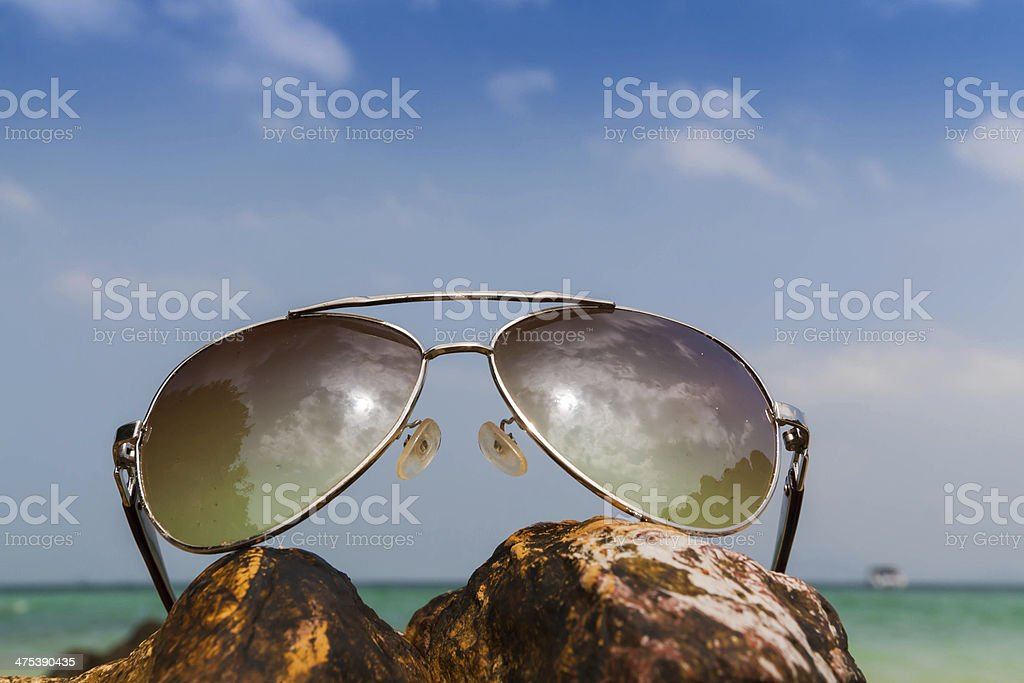 Glasses set on the rock,Beach in Thailand stock photo
