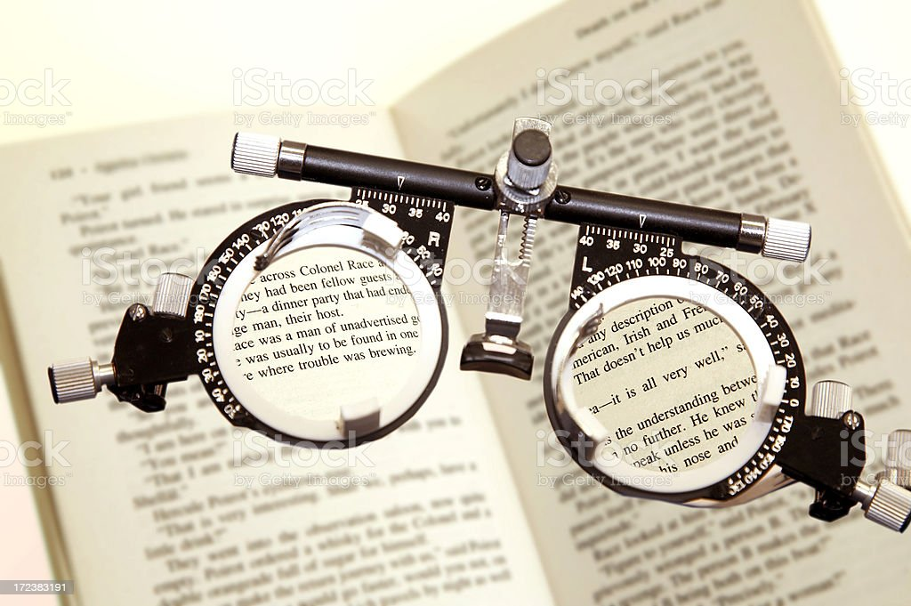 Glasses to test eyesight on book royalty-free stock photo