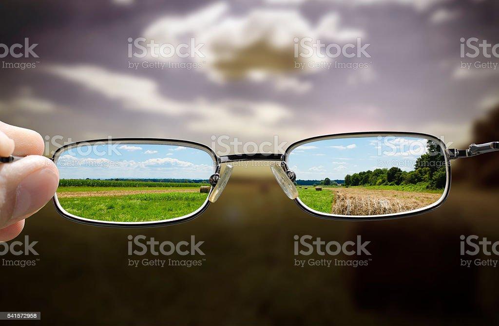 glasses turn gloomy day into sunny stock photo