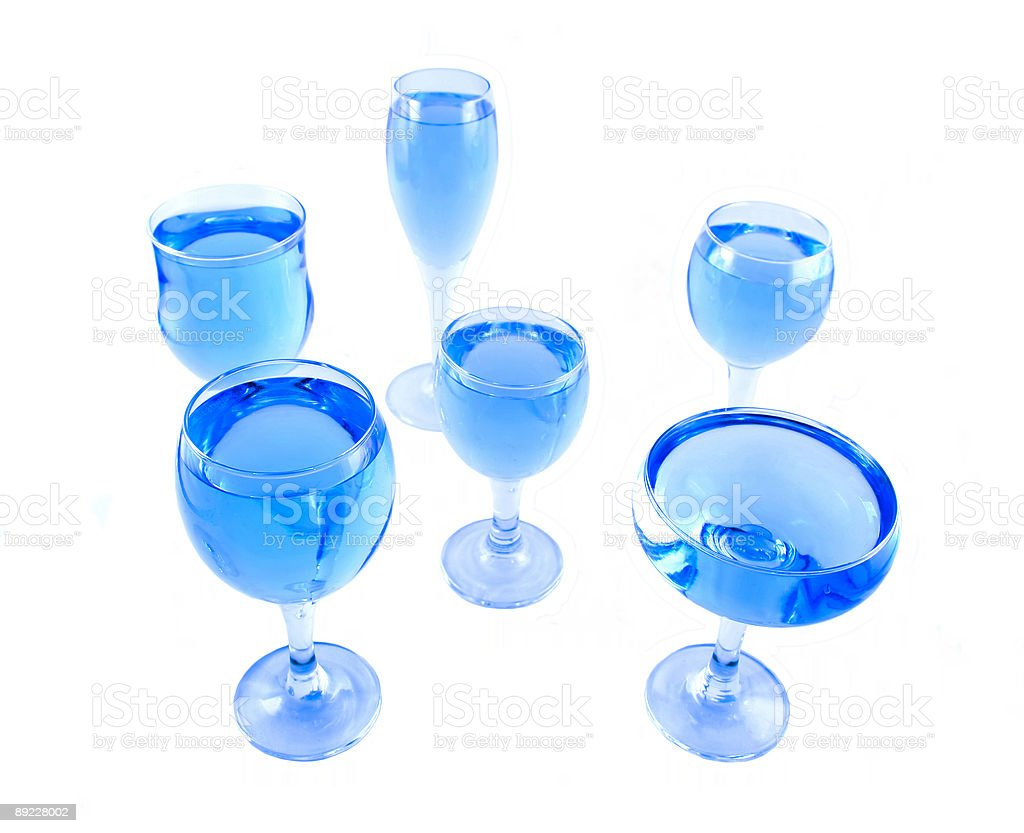Glasses with a blue liquid royalty-free stock photo