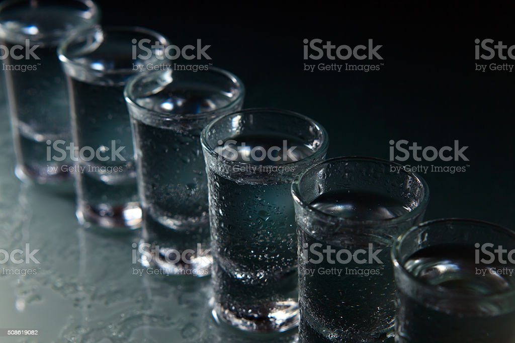 Glasses with alcoholic drink stock photo
