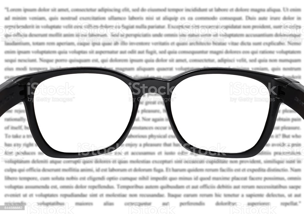 Glasses with blurred vocabulary background, with white copy space stock photo