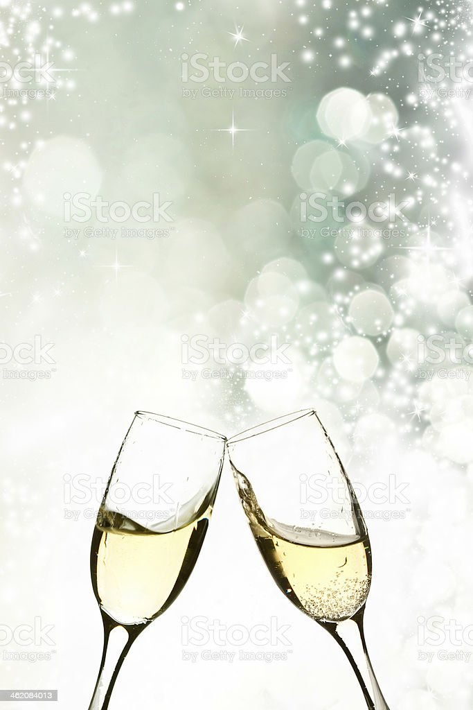 Glasses with champagne against holiday lights stock photo