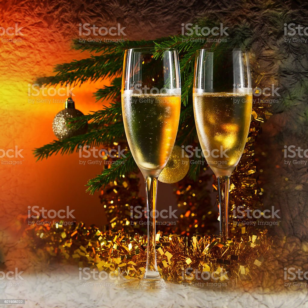 glasses with champagne and Christmas tree stock photo