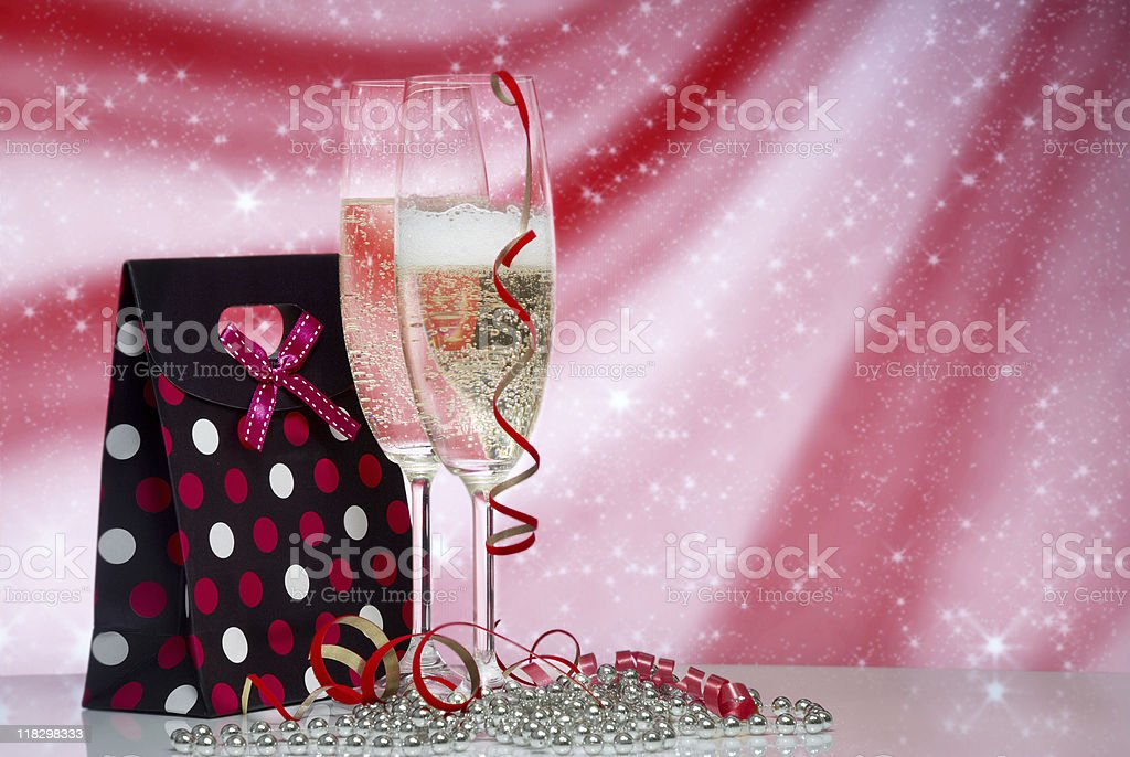 Glasses with champagne and Gift on an abstract background royalty-free stock photo