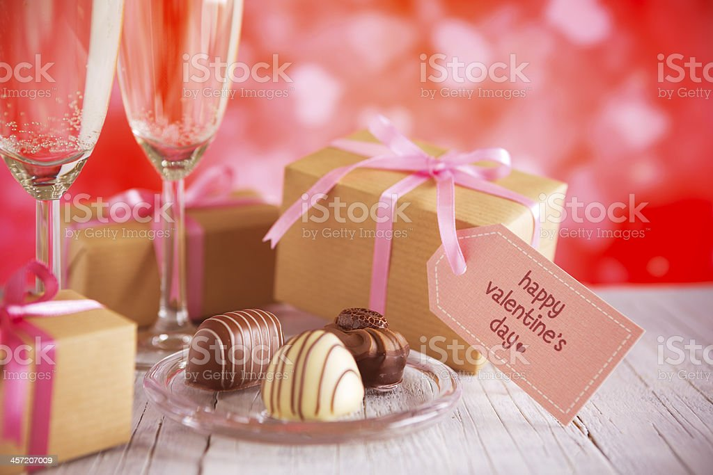 Glasses with champagne, chocolates and Valentine's gifts royalty-free stock photo