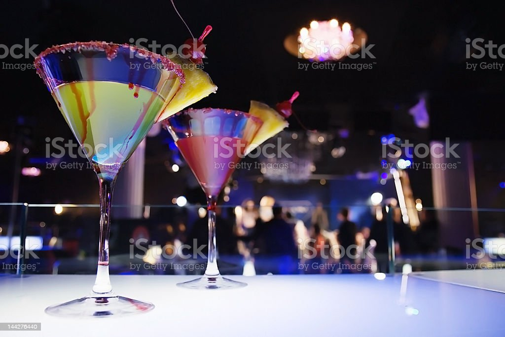 glasses with cocktail in nightclub, royalty-free stock photo