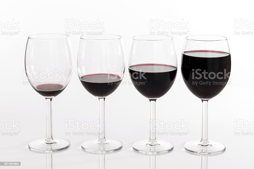 Glasses with different quantities of red wine stock photo