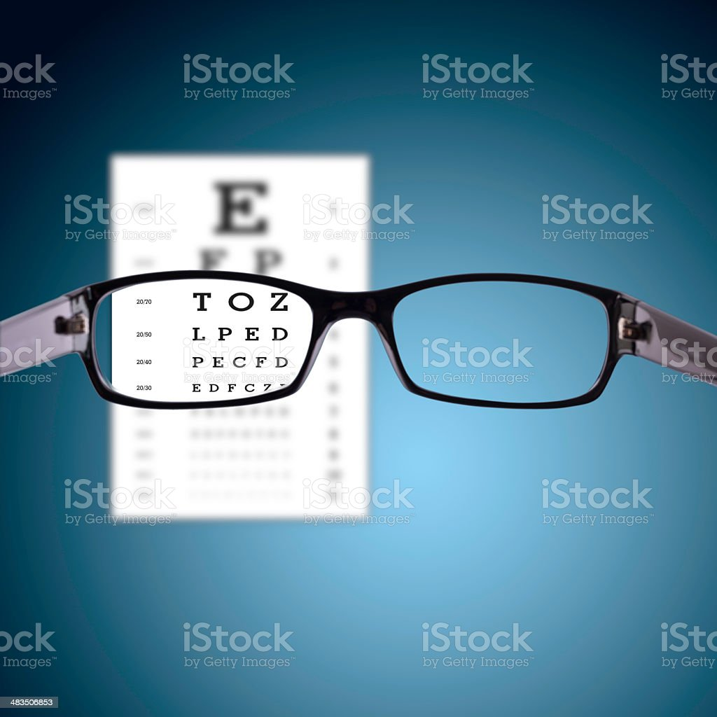 glasses with eye chart stock photo