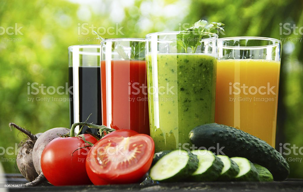 Glasses with fresh vegetable juices in the garden. Detox diet stock photo