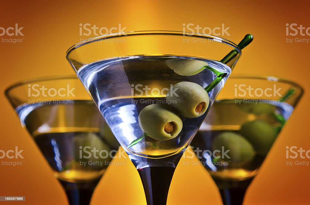 glasses with martini and green olives royalty-free stock photo