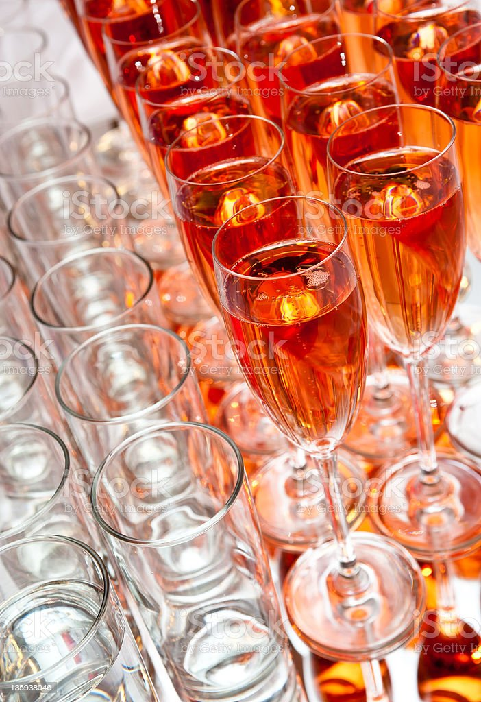Glasses with pink champagne on tray royalty-free stock photo