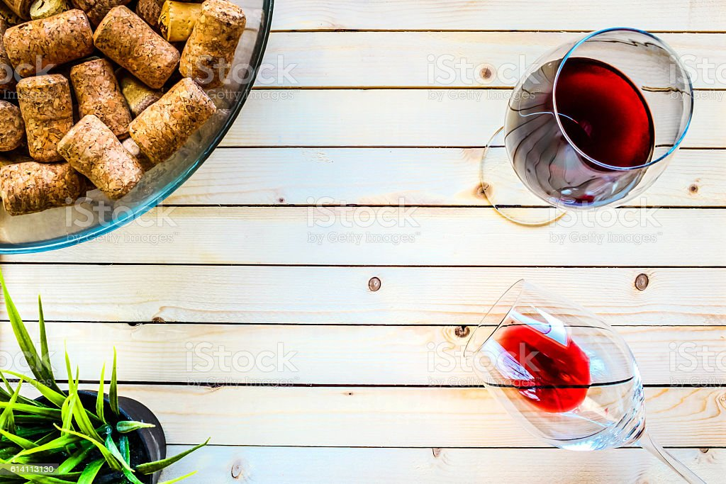 Glasses with red wine on a light wooden table stock photo