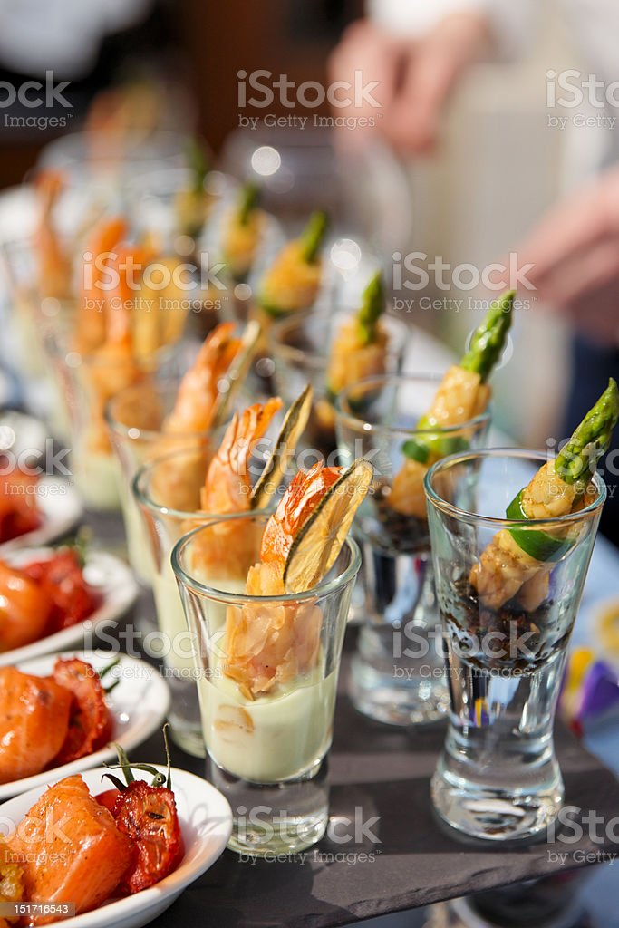 Glasses with seafood snacks stock photo