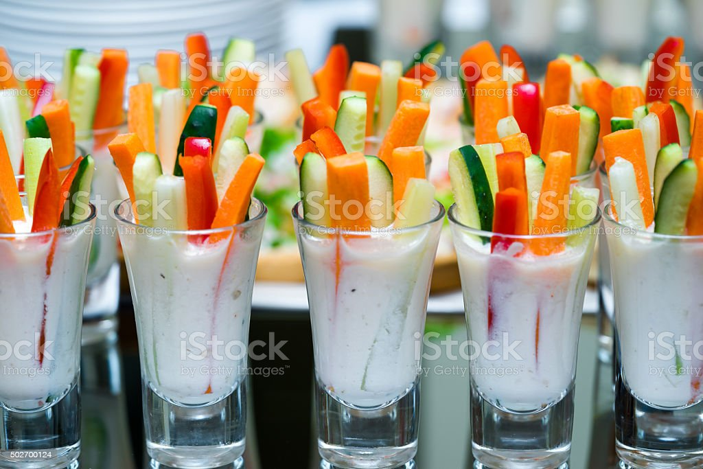 glasses with vegetables snacks on banquet table stock photo