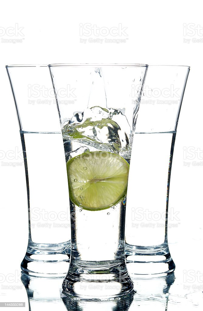 glasses with water and lemon royalty-free stock photo