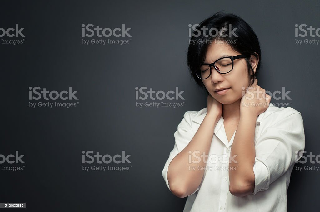Glasses woman neck pain. stock photo