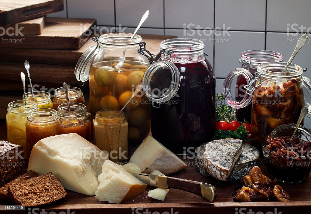 Glassjars with preserves and cheese stock photo