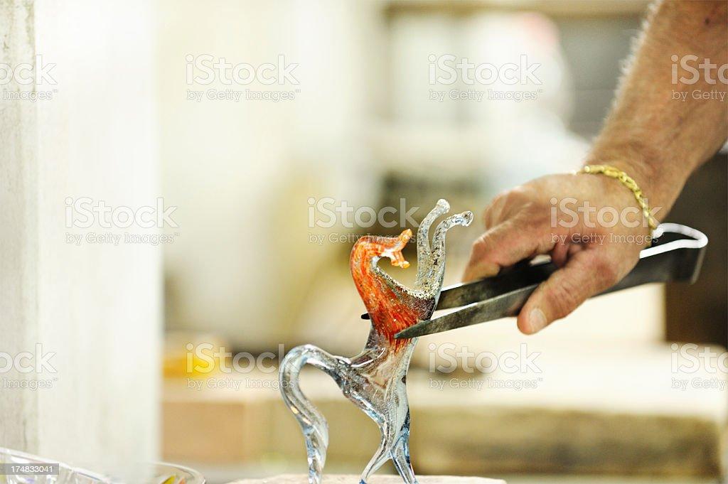 Glassmaker finishing horse ornament stock photo