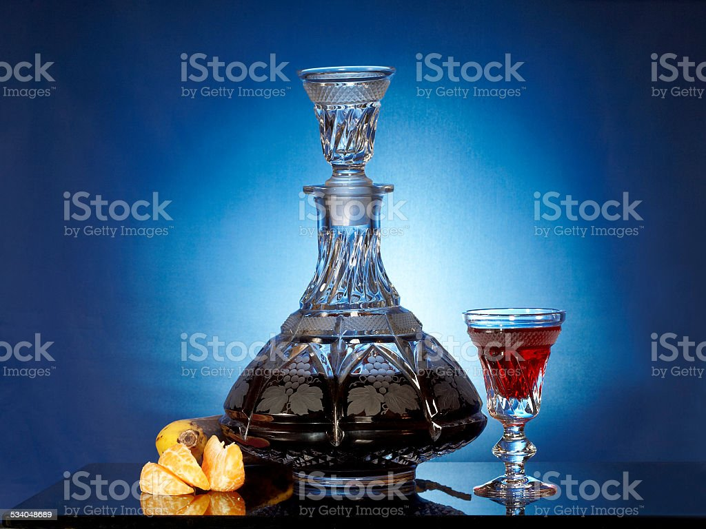 Glassware with liqueur and fruits stock photo