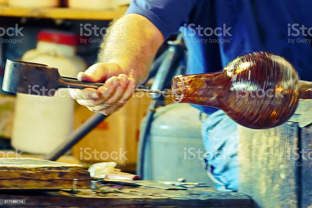Glassworker in action in the Murano glassfactory stock photo