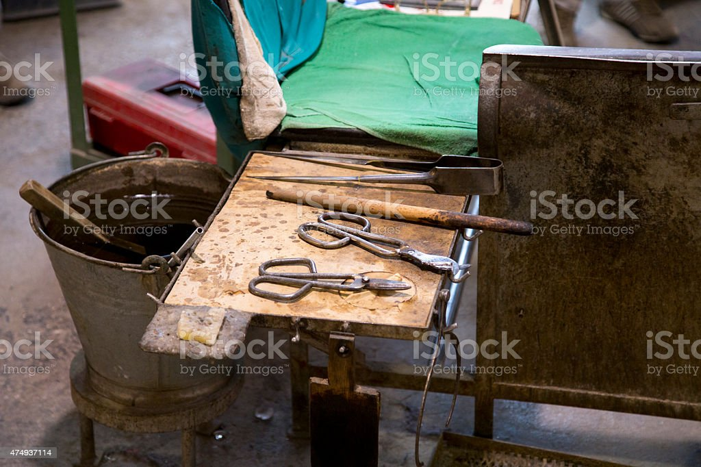 Glassworks tools closeup view using for glass manufacturing process stock photo
