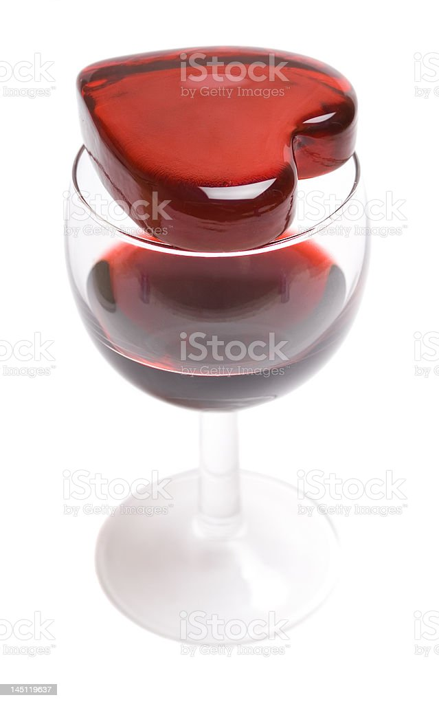 Glassy heart on a glass of wine royalty-free stock photo