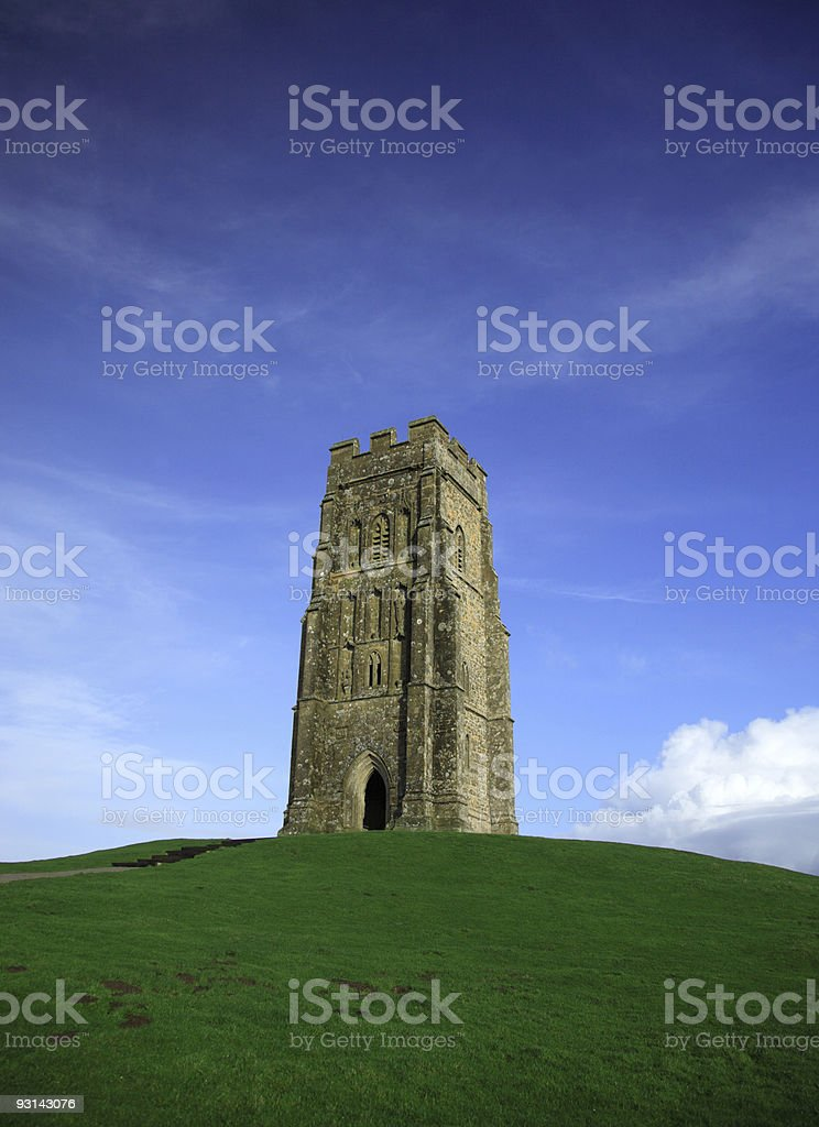 Glastonbury Tor against a vivid blue sky royalty-free stock photo