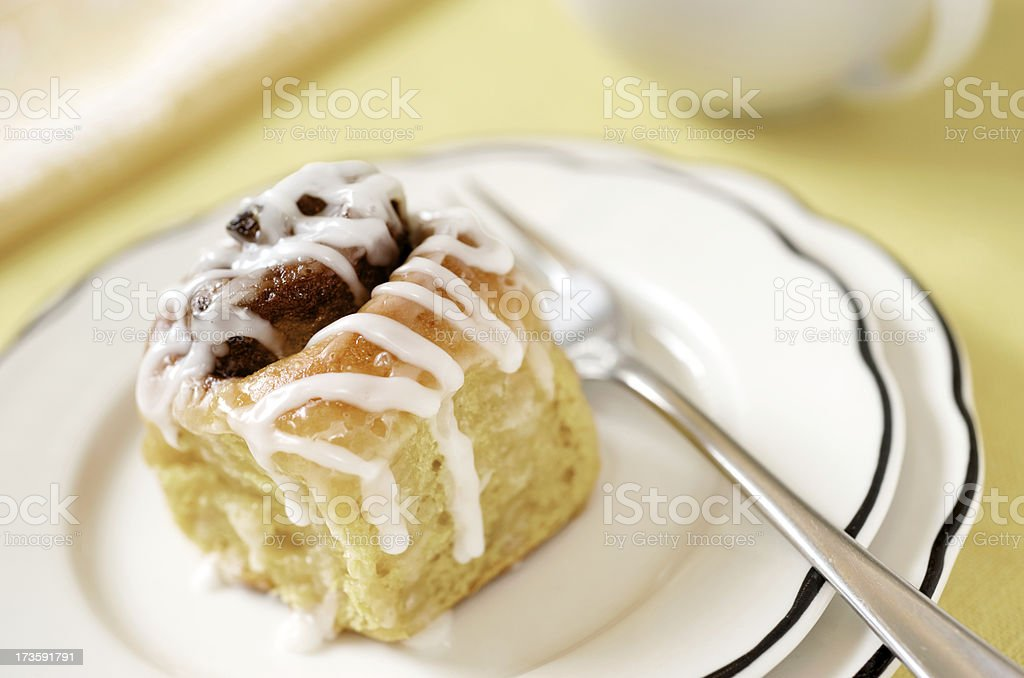 Glazed Cinnamon Roll with White Plate. Coffee Cup royalty-free stock photo
