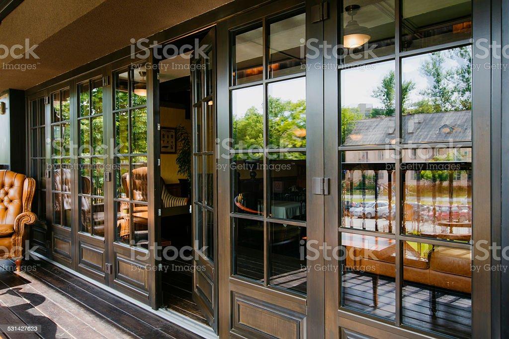 Glazed entrance to the luxurious restaurant - door opens stock photo