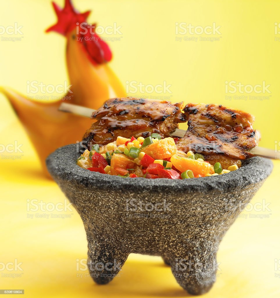 Glazed grill chicken with salsa stock photo