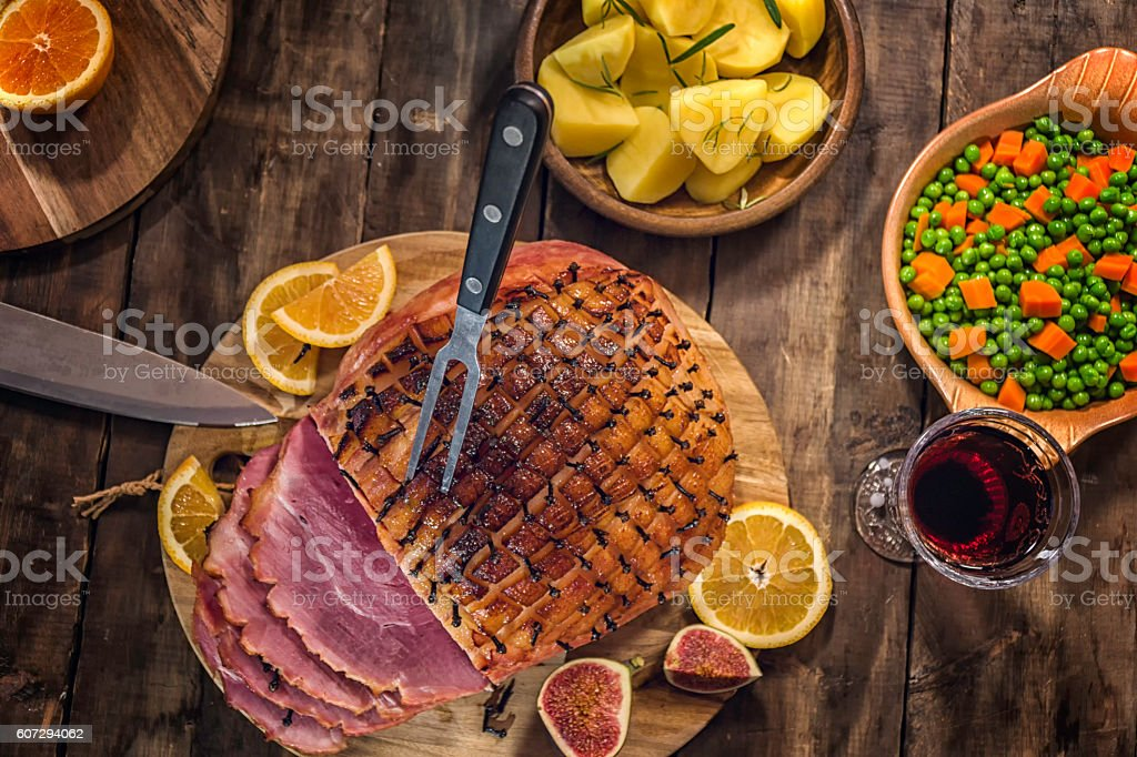Glazed Holiday Ham with Cloves Background stock photo