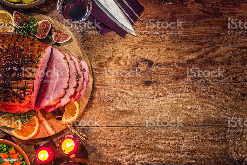 Glazed Holiday Ham with Cloves Background stock photo
