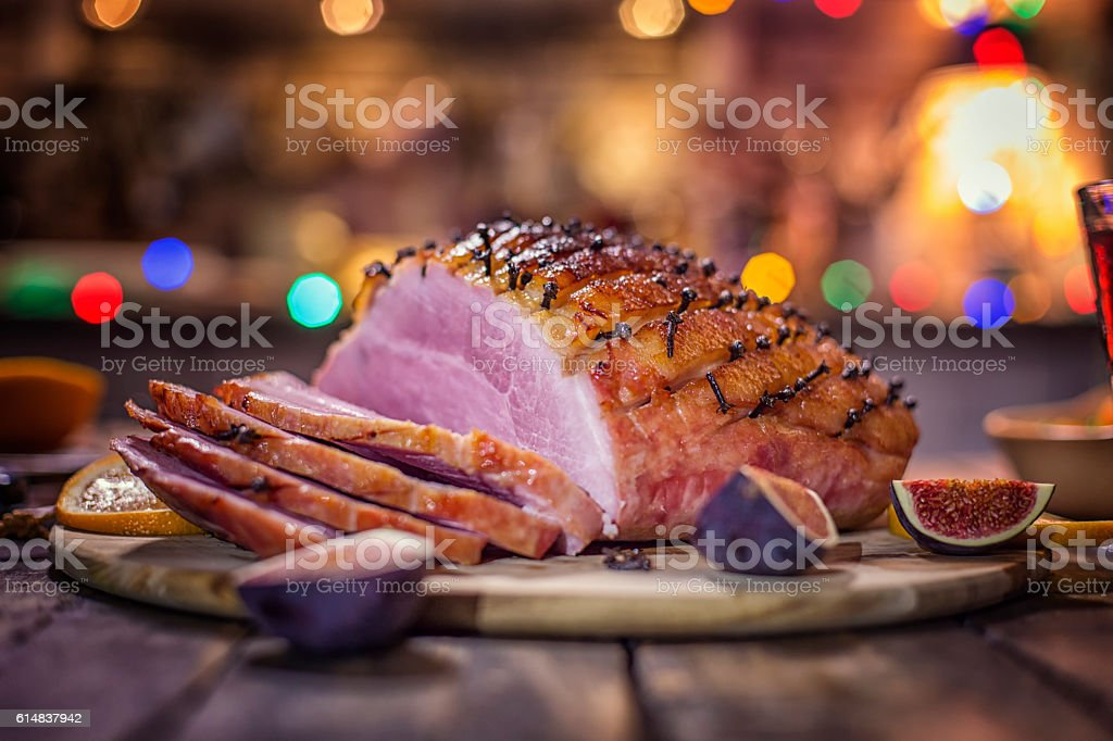 Delicous Glazed Holiday Ham with Cloves Served for Dinner