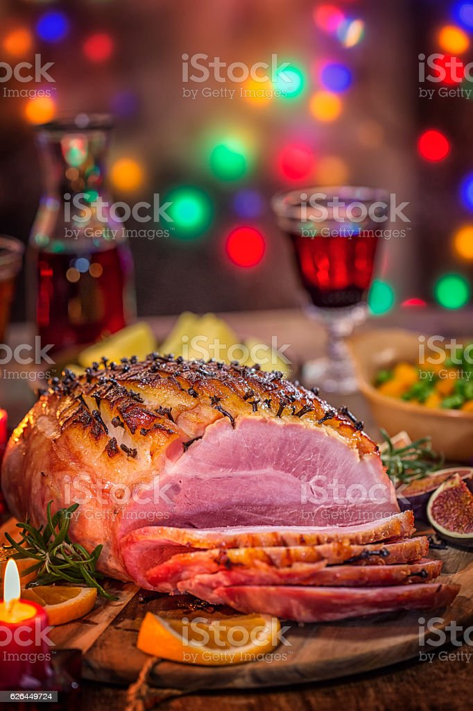 Glazed Holiday Ham with Cloves Served for Dinner stock photo