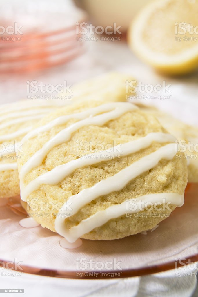 Glazed Lemon Cookies on a Pink Glass Plate Close-up stock photo
