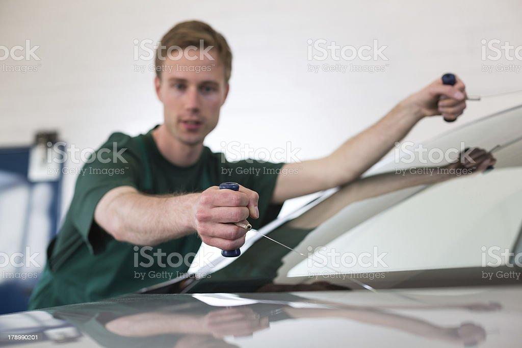 Glazier removing windshield royalty-free stock photo