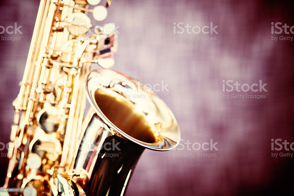Gleaming golden alto sax, close up and cropped stock photo