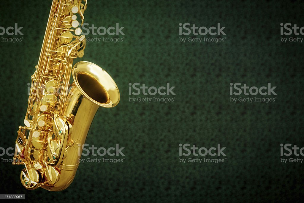 Gleaming golden saxophone on dark background with copy space royalty-free stock photo