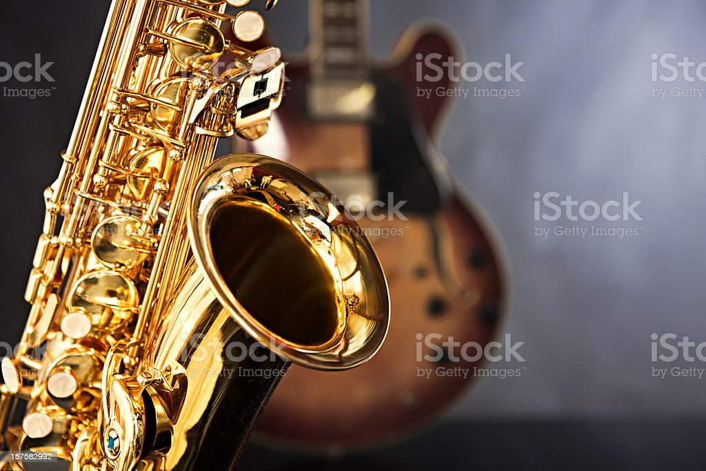 Gleaming saxophone takes the lead with guitar as back up stock photo