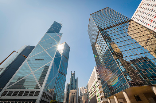 ea1f16eaa3d4 Gleaming Skyscrapers Futuristic Cityscape Soaring Into Blue Sky Hong Kong  Stock Photo   More Pictures of Architecture