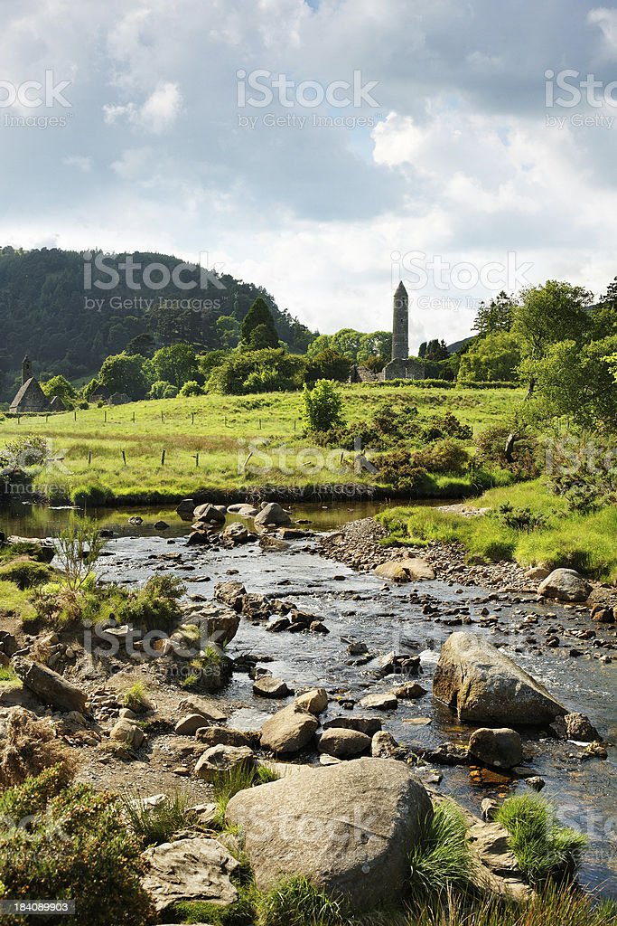 Glendalough creek with old celtic ruins stock photo