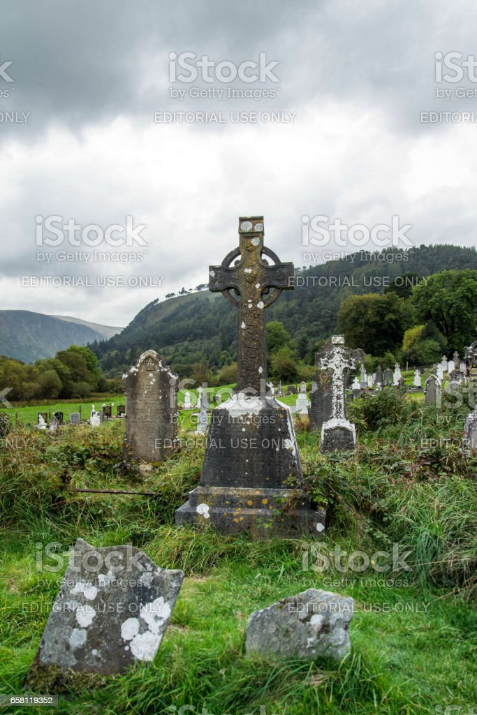 Glendalough, Wicklow County, Ireland. October 2, 2016. Old Celtic cross headstones in Glendalough Cemetery in the Wicklow Mountains. stock photo