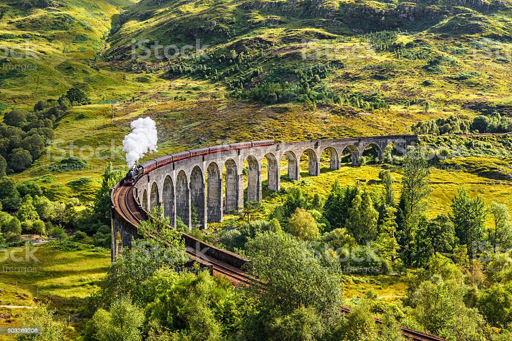 Glenfinnan Railway Viaduct in Scotland with a steam train stock photo