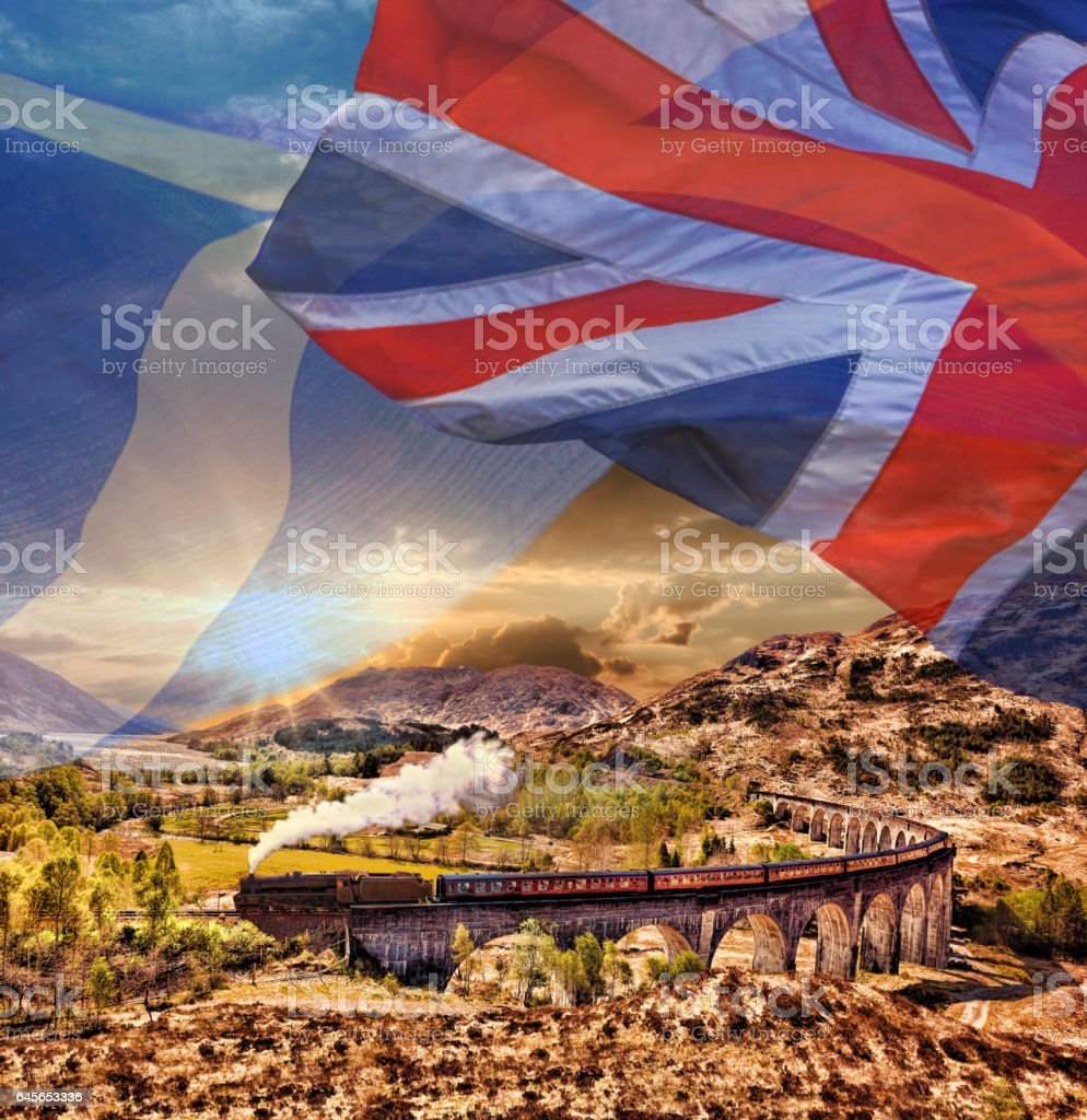 Glenfinnan Railway Viaduct in Scotland with the Jacobite steam train against scottish ang british flags stock photo