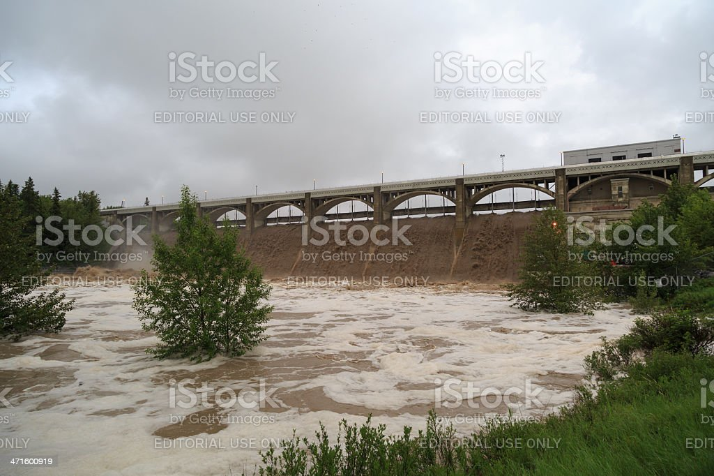 Glenmore Reservoir Dam opens its spillway to release floodwaters stock photo