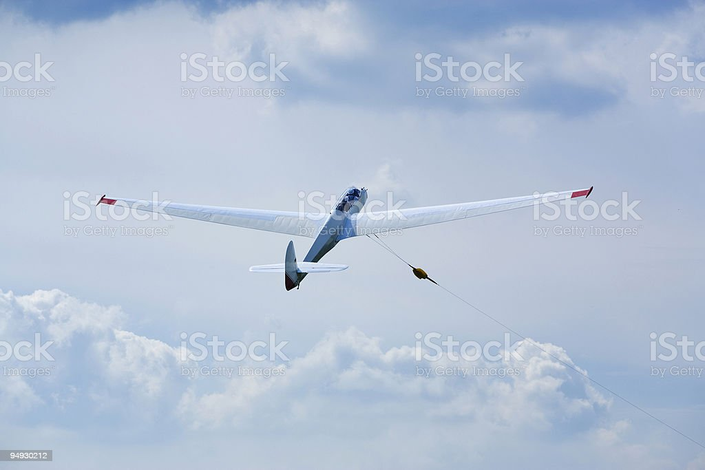 glider being winched upwards stock photo